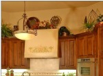 How to decorate above your kitchen cabinets